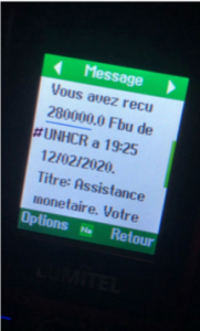 A phone screen, with text in French indicating that a cash transfer was received.