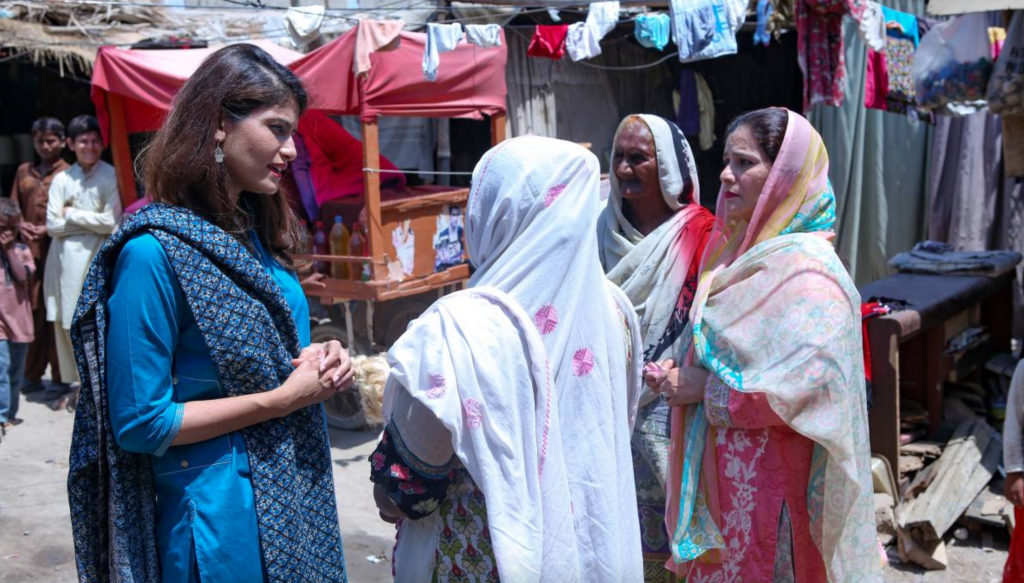 Dr Sara Saeed Khurram talks to patients near a Sehat Kahani telemedicine clinic in Model Colony, on the outskirts of Karachi (Source: Thomson Reuters Foundation/Handout by Sehat Kahani)