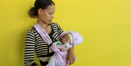 A mother and her newborn child at the new hospital in Suai, Timor-Leste.