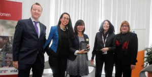 (l-r) Sarah Fathallah (second from left) and Angel Kittiyachavalit (centre) accept the Grand Prize for their team's design 'Sahel Shake' and are congratulated by Chris Locke, GSMA (left), Cynthia Gordan, Oredoo (second from right) and Maura O'Neill, USAID